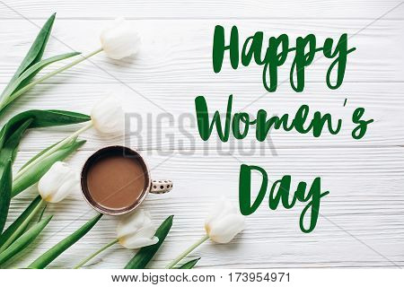 Happy Womens Day Text Sign On Tulips And Coffee On White Wooden Rustic Background. Stylish Flat Lay