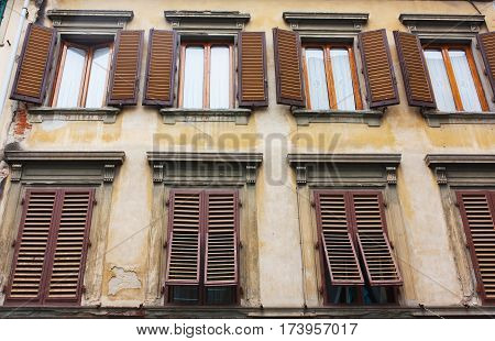 Old house with brown shutters in Florence Italy (Firenze)