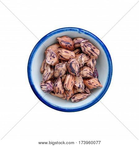 Raw Organic Pinto beans in bowl on white. This has clipping path.