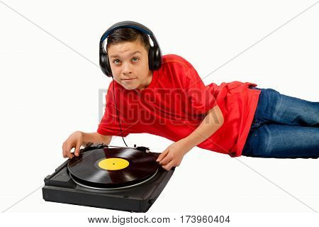 Teenage boy putting a LP on a player