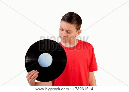 Teenage boy looking at LP in his hand