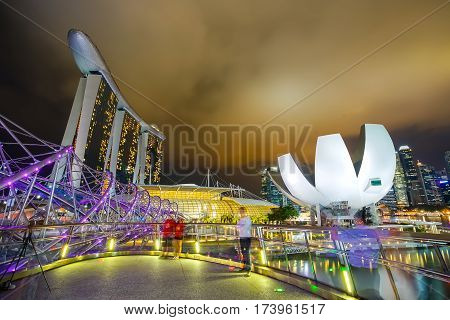 MARINA BAY SINGAPORE - JAN 20 2017: Landscape of the ArtScience Museum Felix bridge and Marina bay sands in Singapore.