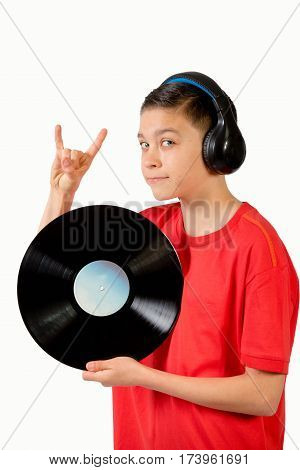 Teenage boy holding a LP and making a rock n roll gesture