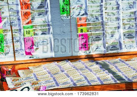 PATTAYA THAILAND - JANUARY 25: This is a Thai lottery stand which sells tickets on the street to local people which is a common way for people to buy lottery tickets in Thailand on January 25 2017 in Pattaya