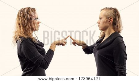 Self talk concept. Young blond caucasian woman talking to herself showing gestures. Double portrait from two different side views.