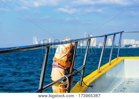 Life buoy ring on a boat with out of focus sea in the background