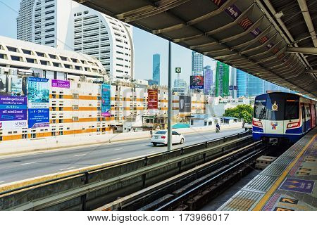 BANGKOK THAILAND - JANUARY 30: BTS Sky train station platform with a view of downtown Bangkok buildings in the background on January 30 2017 in Bangkok