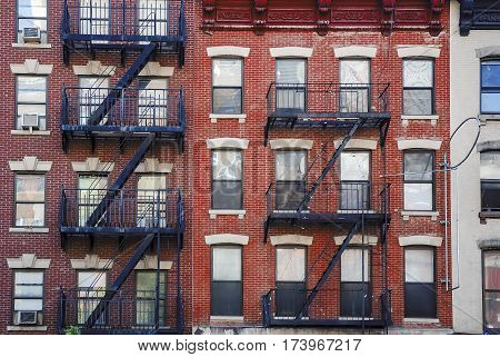 Manhattan old building with fire escapes United states of America