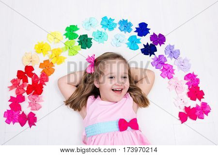 Little Girl With Colorful Bow. Hair Accessory