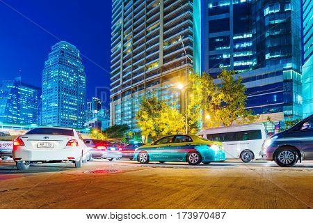 BANGKOK THAILAND - FEBRUARY 01: Cars waiting in traffic in downtown Bangkok Asoke area at night on February 01 2017 in Bangkok