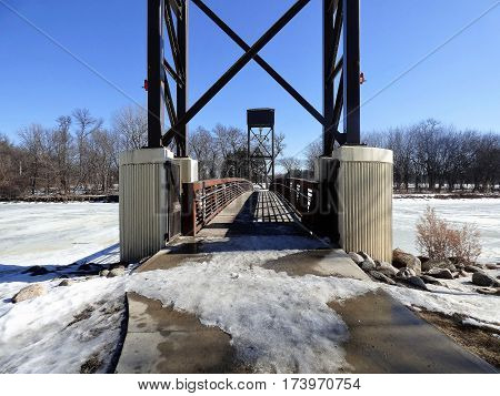 A walking bridge between two City Parks over the Red River  that connects walking paths.The bridge can be raised during spring flooding.