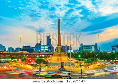 BANGKOK THAILAND - FEBRUARY 02: Evening view of victory monument with cars speeding passed and ligh trails on February 02 2017 in Bangkok