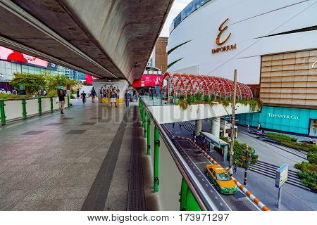 BANGKOK THAILAND - FEBRUARY 03: This is view of the entrance of the Emporium shopping mall and an overpass leading to other luxury malls in the downtown area on February 03 2017 in Bangkok