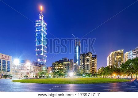TAIPEI TAIWAN - JANUARY 01: This is a night view of Taipei 101 and Xinyi financial district apartments and buildings with Xinyi Junior high school running track on January 01 2017 in Taipei