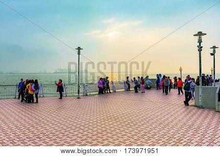 TAIPEI TAIWAN - JANUARY 05: People on Fisherman's wharf pier during sunset in the tamsui area of Taipei on January 05 2017 in Taipei