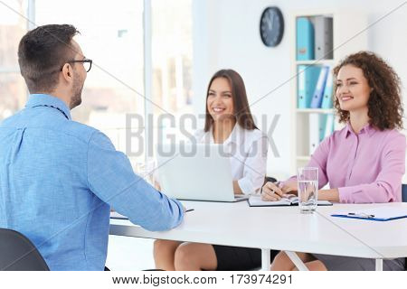 Job interview concept. Human resources commission interviewing man