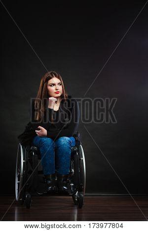 Sad Girl On Wheelchair.