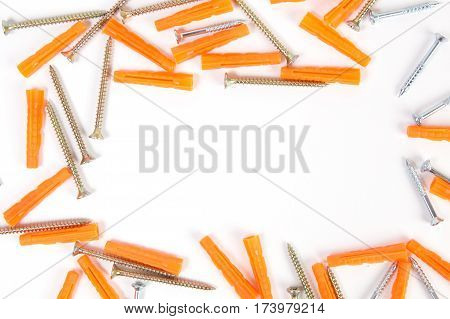 Screws and dowels isolated on white background.