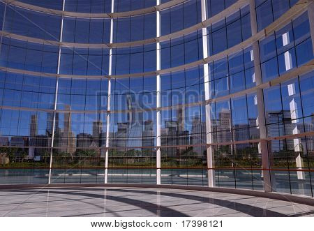 View of the city in the window of a modern building.