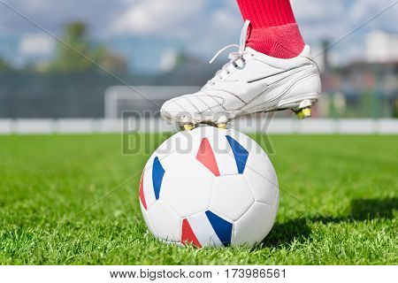 Soccer ball with French flags, toned image, horizontal image, selective focus