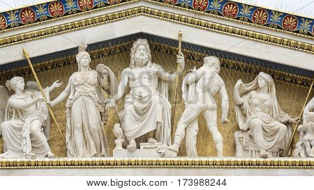 ATHENS, GREECE, SEPTEMBER 8, 2016: Statues of ancient Greek gods at Academy Of Athens, Greece's national academy, and the highest research establishment in the country.