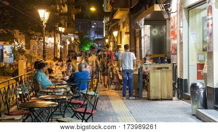 ATHENS, GREECE, SEPTEMBER 7, 2016: People sitting at the cafe's at the streets of Plaka, Athens, Greece