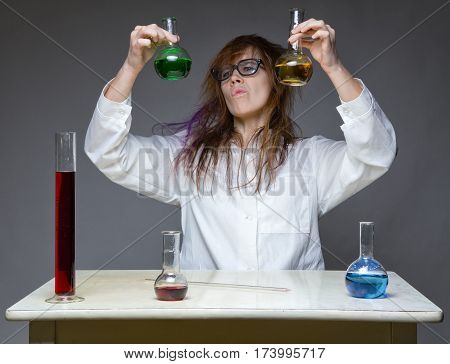 Choice and shaggy scientist in lab on gray background