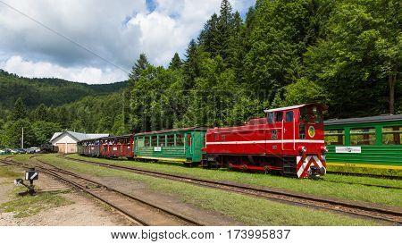 BieszczadyPoland-JULY 142014: Train of Biaszczadzka Railway with tourist leaving Majdan Station heading to Balnica Station