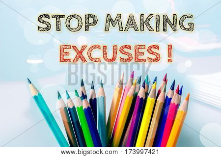 Stop making excuses, text message on blue background with color pencil