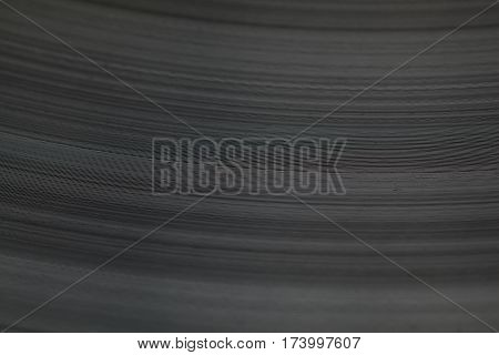 Macro of soundtrack grooves on vinyl music plate textured background