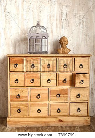 Wooden Chest Of Drawers In Shabby Styled Room
