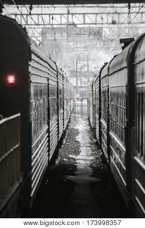 Two trains in train station, perspective view