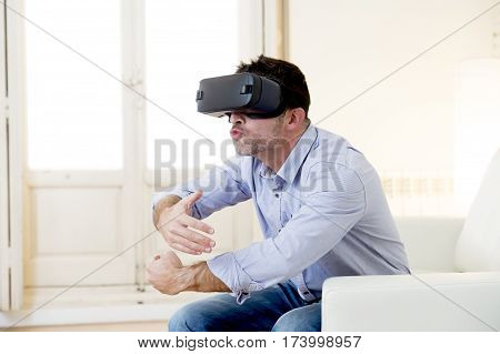 young man at home living room sofa couch excited using 3d goggles watching 360 virtual reality vision enjoying as if kissing virtual woman brest in cyber sex experience vr simulation reality
