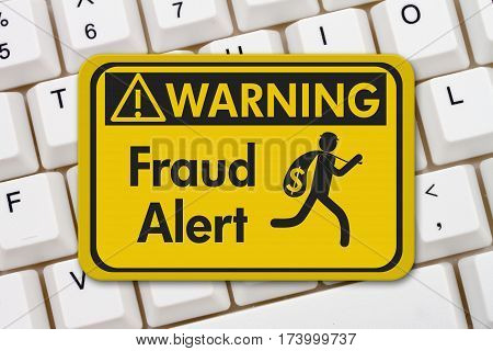 Fraud alert warning sign A yellow warning sign with text Fraud Alert and theft icon on a keyboard 3D Illustration