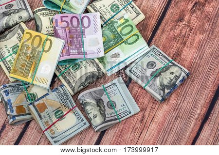 Dollar vs euro notes as background for business concept.