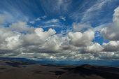 Beautiful cumulus clouds over the fields of scoria. North Breakthrough Great Tolbachik Fissure Eruption 1975 poster