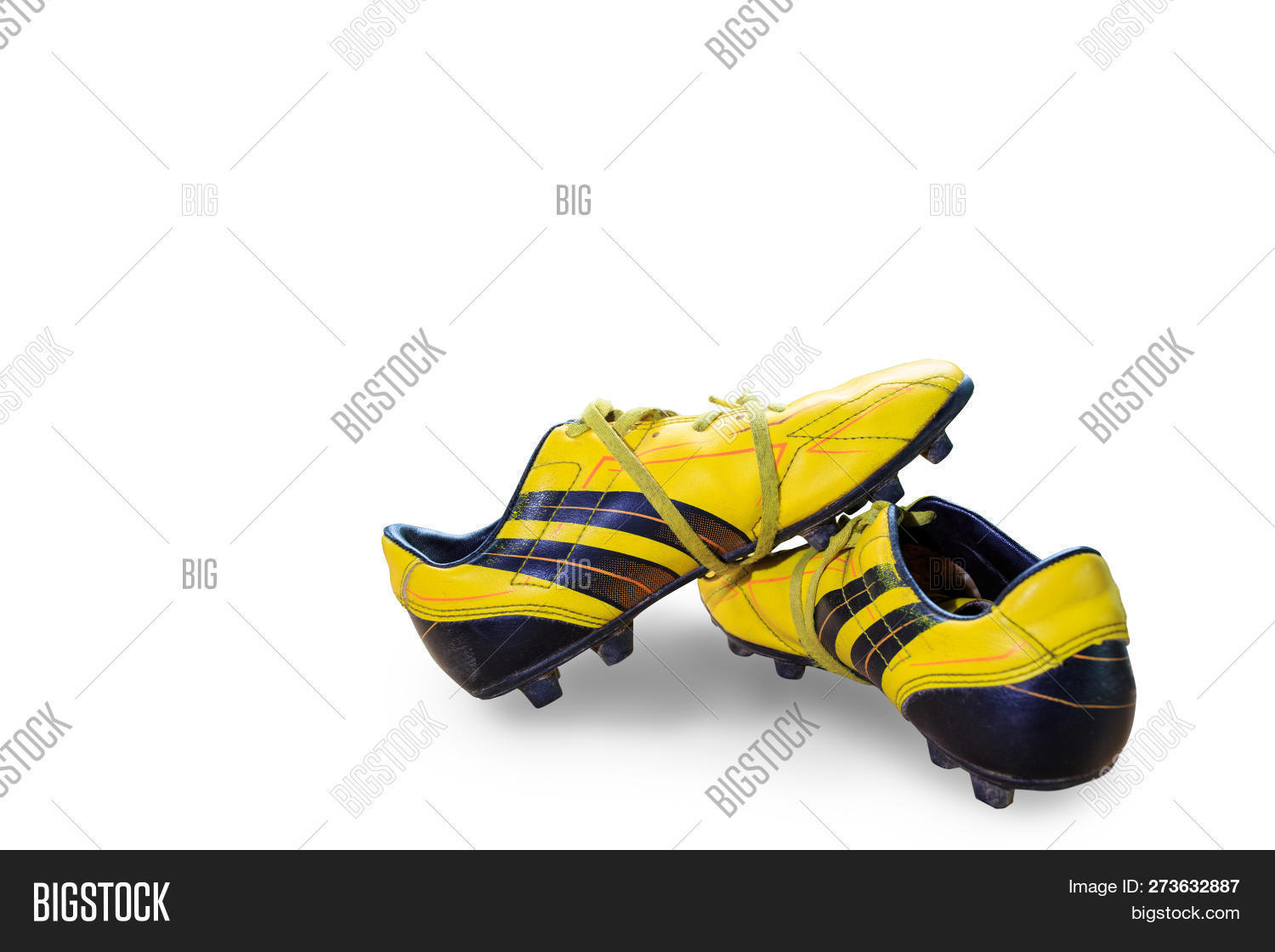 636f76c32 A Pair Of Old Football Boots Old Yellow Football Shoes Placed On A Wooden  Board,
