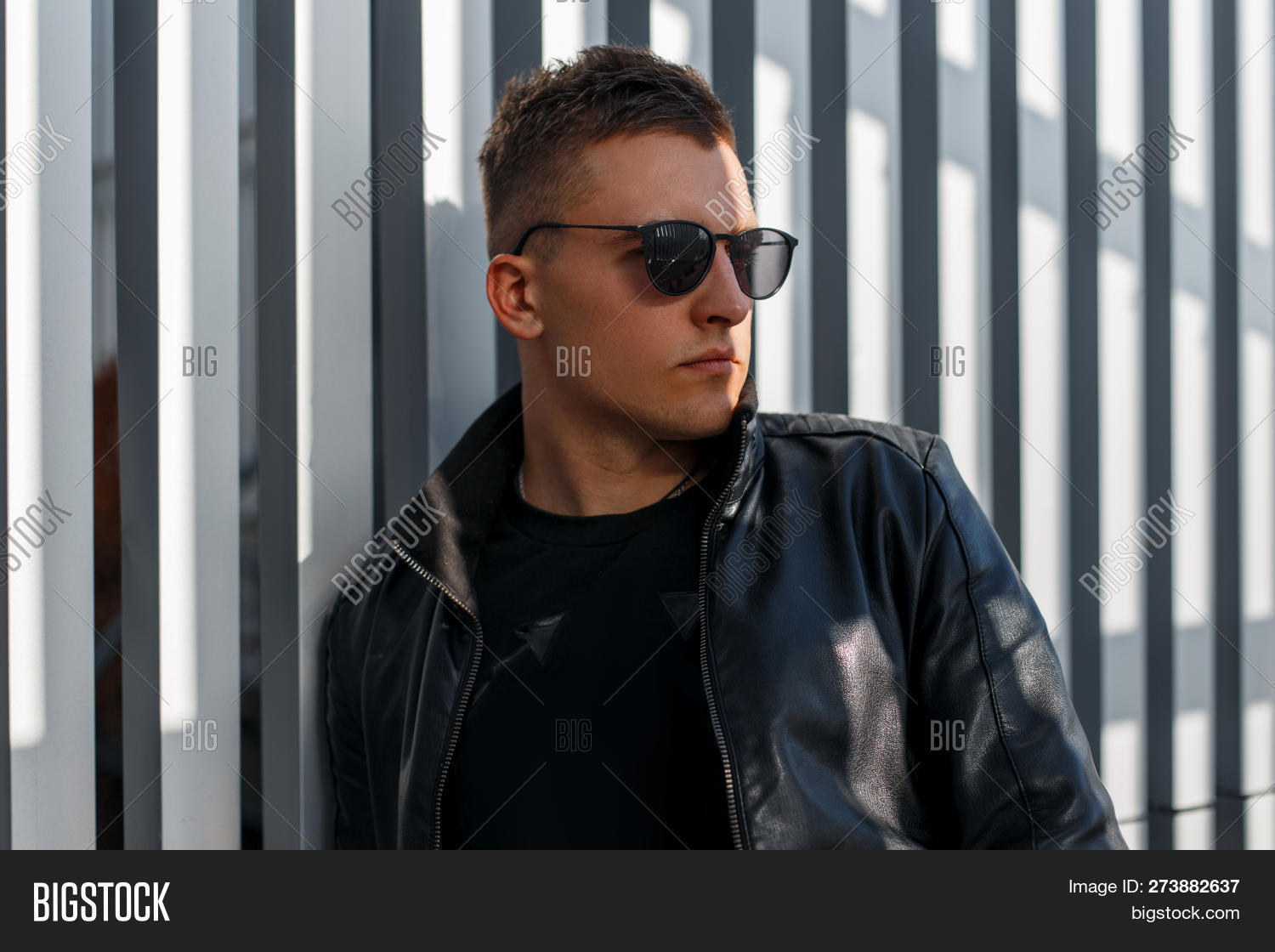 59a825e961b Attractive young hipster man with hairstyle in black sunglasses