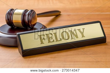 A Gavel And A Name Plate With The Engraving Felony