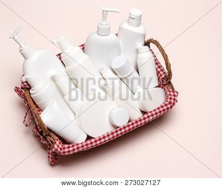 Wicker Basket Filled With Cosmetics. Variety Of Different Cosmetic Products. Close-up, Top View