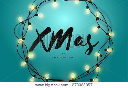Glowing Garland On A Turquoise Background. Merry Christmas And Happy New Year Inscription. New Year