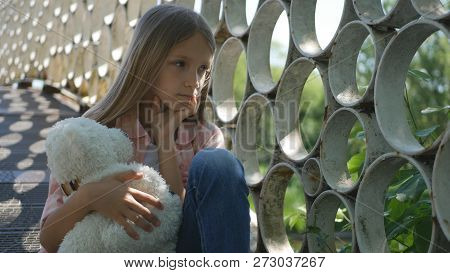 Sad Child In Park, Unhappy Thoughtful Girl Outdoor, Bored Pensive Kid On Bridge
