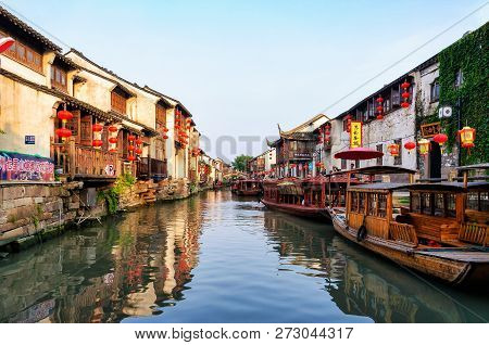 Suzhou, China - August 12, 2011: A Canal In The Middle Of Typical Houses With Paper Lantern And Wood