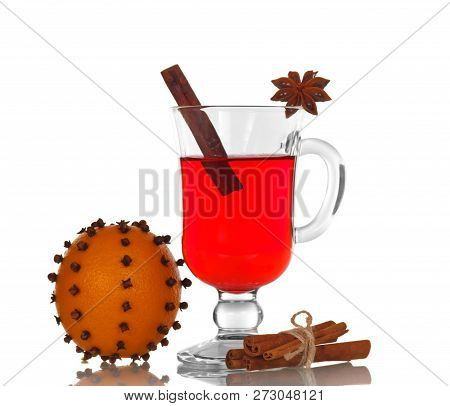 Hot Spiced Mulled Wine And Orange Flowered Carnations Isolated On White Background