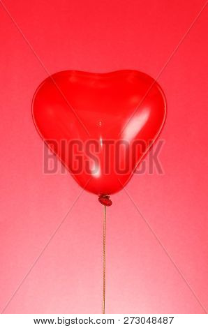 Bright Red Heart Balloon For Valentine's Day On Red