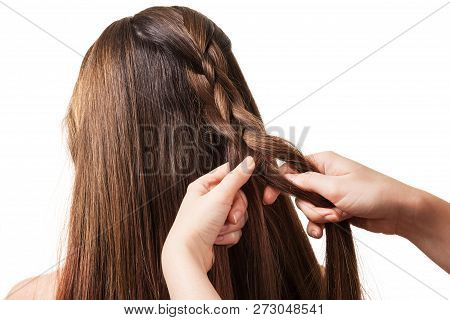 The Hands Of The Stylist Weaves Long, Silky Hair, Isolated On White Background