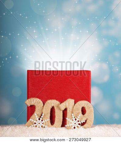 Big Red Box Of Magic On A Blue Background And The Inscription 2019 New Year