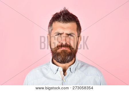 Serious Bearded Man In Casual Clothes. Fashion Model With Stylish Hair. Serious Man With Long Beard