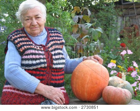 Grandmother With Pumpkins
