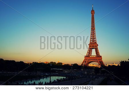 Sunset View Of Eiffel Tower In Paris, France. Summer Paris. Architecture And Landmarks Of Paris. Pos